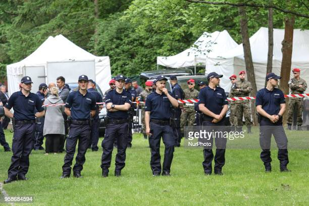 Police and military police officers defending the entrance to the cemetery are seen in Gdansk Poland at the Srebrzysko cemetery on 14 May 2018 The...
