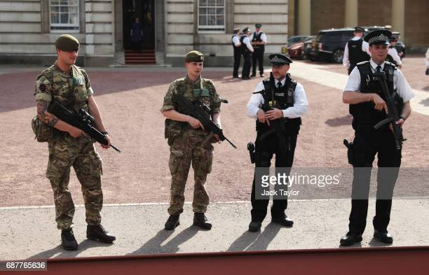 Police and Military presence seen outside Buckingam Palace on May 24 2017 in London England The UK terror status is elevated to Critical in the wake...