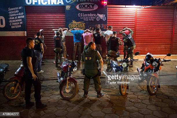 Police and military raid a bar in one of Altamira's poorer districts frisking every patron Altamira has seen a surge in every type of violent crime...