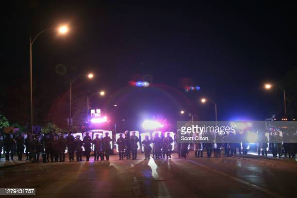 Police and National Guard advance on protestors occupying the street near the Wauwatosa City Hal on October 09, 2020 in Wauwatosa, Wisconsin. The...