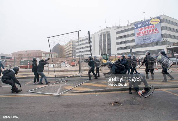Police and 'No Global' protesters clash in Piazzale Roma during an antifascist rally on December 14 2013 in Venice Italy There were clashes today...