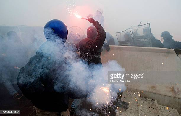 Police and 'No Global' protesters clash on the Calatrava bridge during an antifascist rally on December 14 2013 in Venice Italy There were clashes...