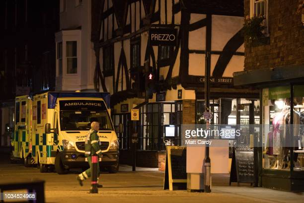 Police and other emergency service personal gather outside Prezzo restaurant which has been closed after two people became ill earlier this evening...