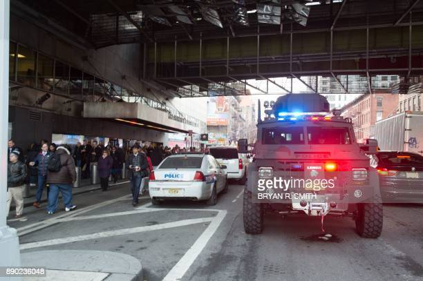 Police and other first responders respond to a reported explosion at the Port Authority Bus Terminal on December 11 2017 in New York New York police...