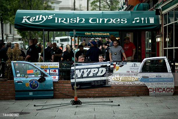 Police and others patronize the Irish Times bar May 14 2012 in Washington DC Police and emergency workers from around the United States and abroad...