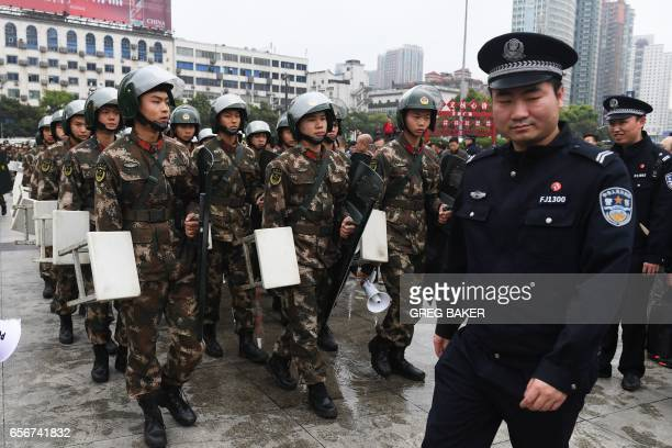 Police and paramilitary police get into position outside the Helong stadium before the World Cup football qualifying match between China and South...