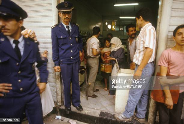 Police and people in a shop during the state of siege in October 1988 in Algeria