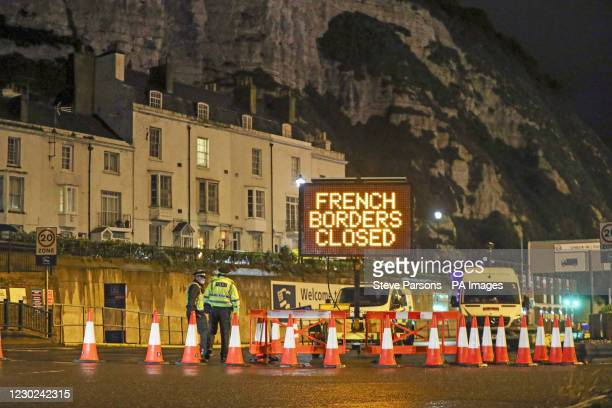 Police and port staff turn away vehicles from the Port of Dover in Kent which has been closed after the French government's announcement it will not...