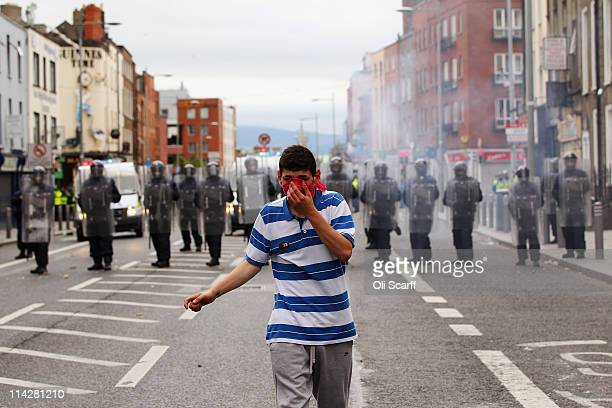 Police and protesters clash in the streets adjacent to the Garden on Remembrance where Queen Elizabeth II laid a wreath on May 17 2011 in Dublin...