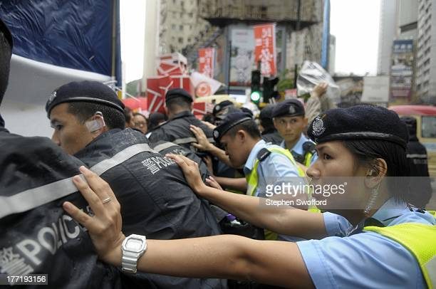 Police and protesters clash in wan chai during the establishment day march. Protesters called for the resignantion of CY Leung, and for Beijing to...