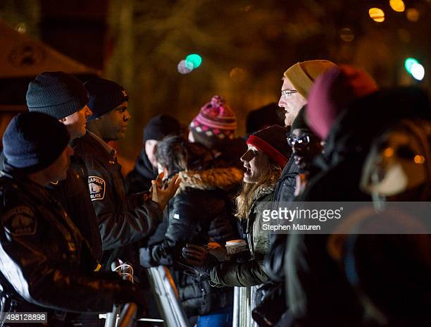 Police and protesters speak separated by a barricade outside the 4th Precinct police station November 20 2015 in Minneapolis Minnesota Activists are...