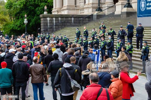 Police and protesters stand off during the Coronavirus AntiLockdown Protest at Parliament House on 10 May 2020 in Melbourne Australia