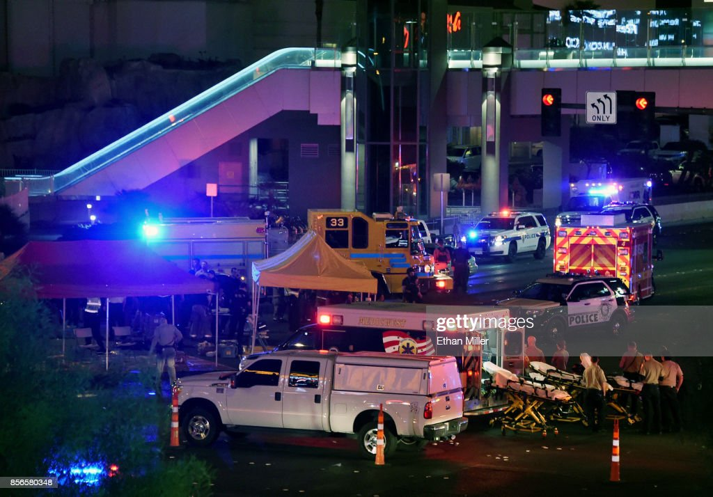Police and rescue personnel gather at the intersection of Las Vegas Boulevard and Tropicana Ave. after a mass shooting at a country music festival nearby on October 2, 2017 in Las Vegas, Nevada. A gunman has opened fire on a music festival in Las Vegas, leaving at least 50 people dead and more than 200 injured. Police have confirmed that one suspect, Stephen Paddock, has been shot and killed. The investigation is ongoing.
