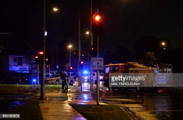Police and rescue vehicles are pictured in the Melbourne bayside suburb of Brighton on June 5 after a woman was held against her will in an apartment...