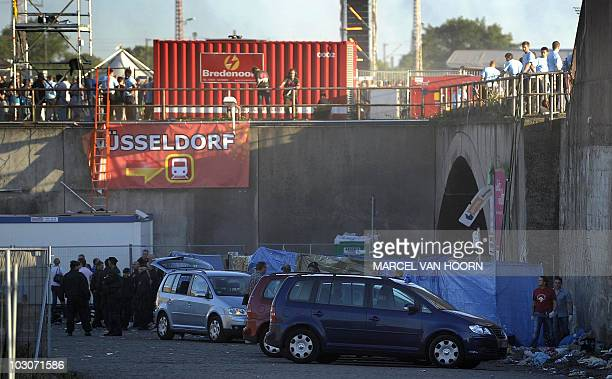 Police and rescue workers at the scene after a mass panic at this year's 'Loveparade' in Duisburg Germany on July 24 2010 At least 15 people died at...