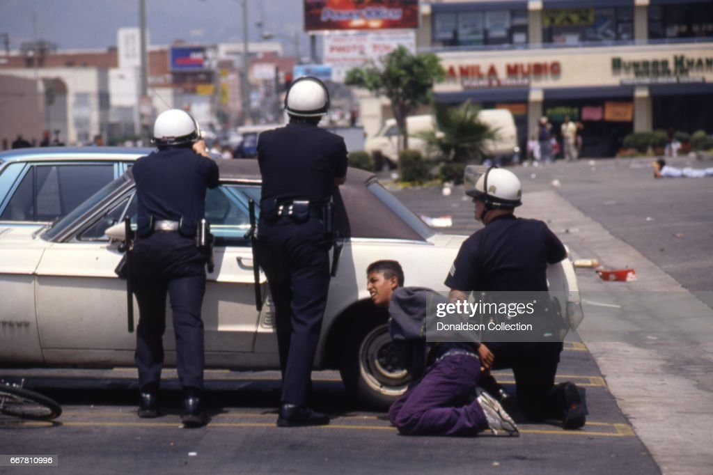 Police and rioters clash at a shopping center located at 116 S. Vermont Ave in widespread riots that erupted after the acquittal of 4 LAPD officers in the videotaped arrest and beating of Rodney King on April 29, 1992 in Los Angeles, California.