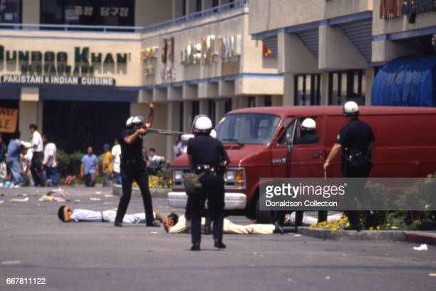 Police and rioters clash at a shopping center located at 116 S Vermont Ave in widespread riots that erupted after the acquittal of 4 LAPD officers in...