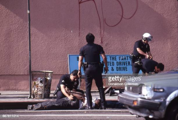 Police and rioters clash in widespread riots that erupted after the acquittal of 4 LAPD officers in the videotaped arrest and beating of Rodney King...