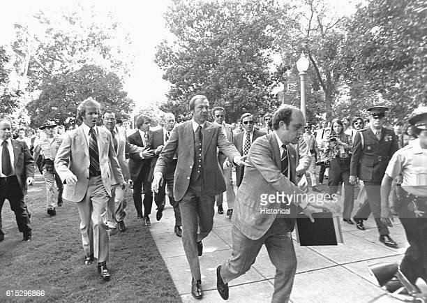 """Police and secret service officers run to protect President Gerald Ford during an attempt at assassination by Lynette """"Squeaky"""" Fromme. September 5,..."""