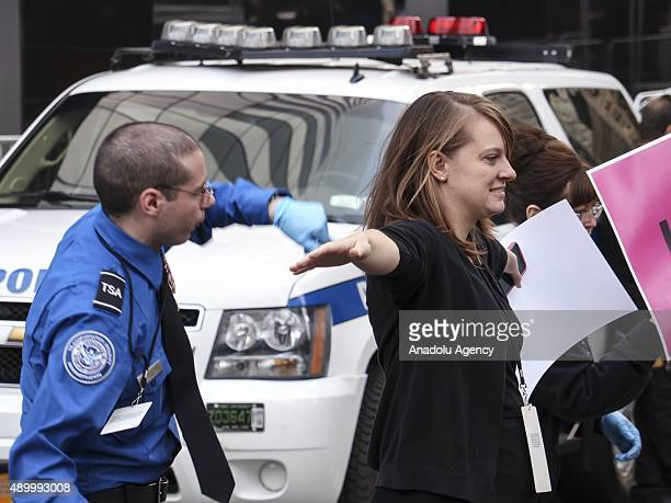 Police and secret service officials frisk the people near the 9/11 Memorial and Museum before the arrival of Pope Francis in New York NY USA on...