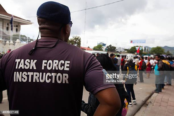 Police and security monitor protesters during AntiAustralia protests on December 6 2013 in Dili East Timor The protests were organized as a strong...