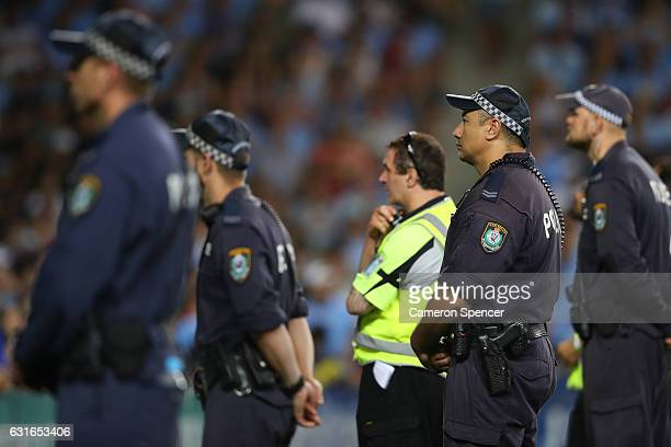 Police and security monitor the crowd during the round 15 ALeague match between Sydney FC and the Western Sydney Wanderers at Allianz Stadium on...