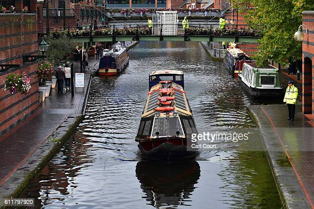 Police and security officers guard a canal next to the building ahead of this week's Conservative Party conference on October 1, 2016 in Birmingham,...