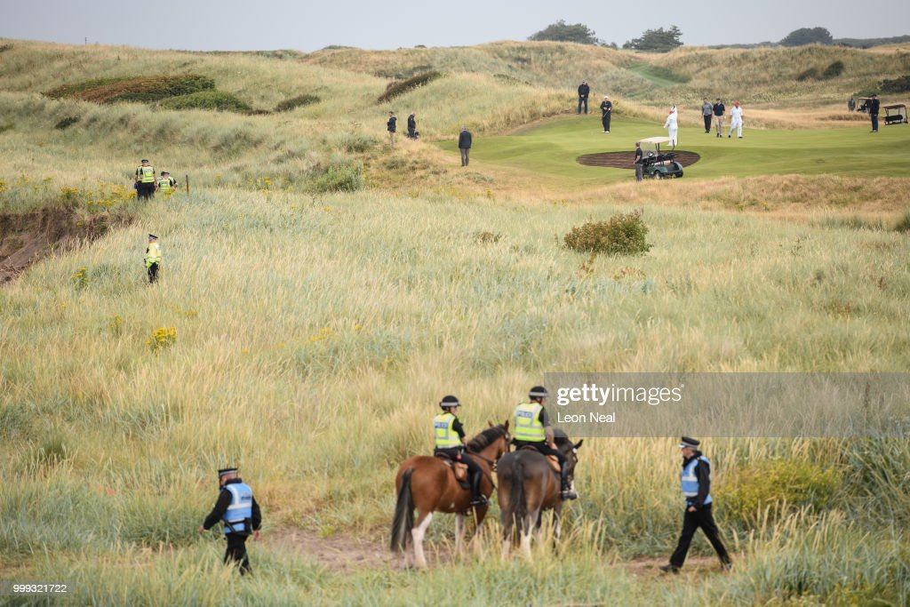 U.S. Police and security services surround the perimeter as President Donald Trump plays a round of golf at Trump Turnberry Luxury Collection Resort during the U.S. President's first official visit to the United Kingdom on July 15, 2018 in Turnberry, Scotland. The President of the United States and First Lady, Melania Trump on their first official visit to the UK after yesterday's meetings with the Prime Minister and the Queen is in Scotland for private weekend stay at his Turnberry.