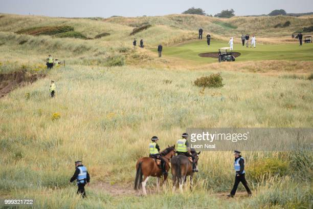S Police and security services surround the perimeter as President Donald Trump plays a round of golf at Trump Turnberry Luxury Collection Resort...