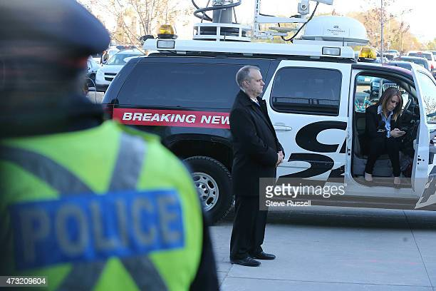 TORONTO ON MAY 13 Police and security surround CP24 reporter Jackie Crandles Maple Leafs Sports and Entertainment provides additional security for...