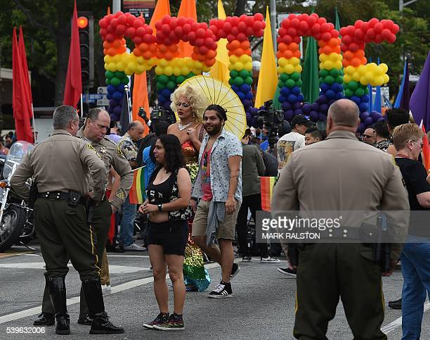 Police and Sheriff's deputies look on during the 2016 Gay Pride Parade on June 12, 20116 in Los Angeles, California. Security for the tightened in...