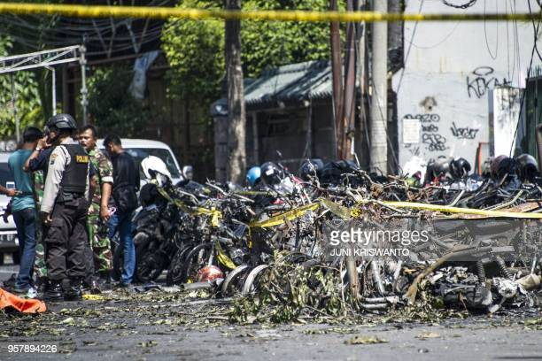 TOPSHOT Police and soldiers examine a site following attacks outside the Surabaya Centre Pentecostal Church in Surabaya East Java on May 13 2018 A...