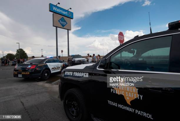 Police and state troopers keep watch outside the Cielo Vista Mall WalMart where a shooting left 20 people dead in El Paso Texas on August 4 2019 The...