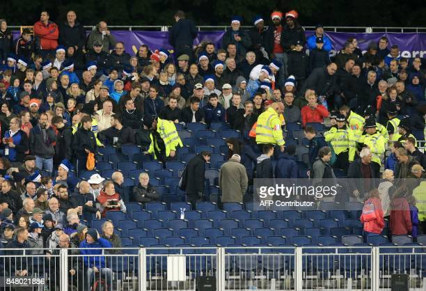 Police and stewards search the stands during the T20 International cricket match between England and West Indies at The Emirates Riverside...