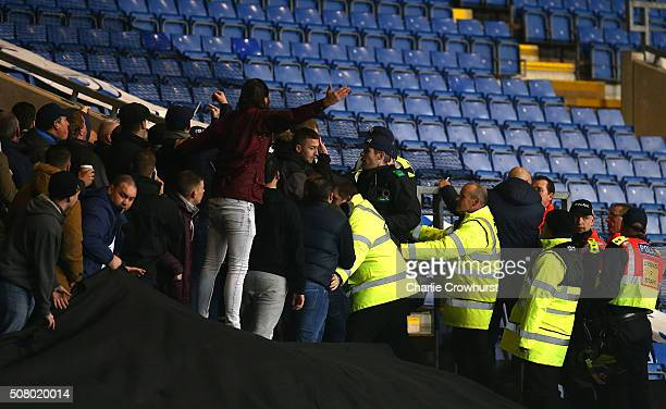 Police and Stewards struggle to contain the Millwall fans during the Johnstone's Paint Trophy southern section semi final second leg match between...