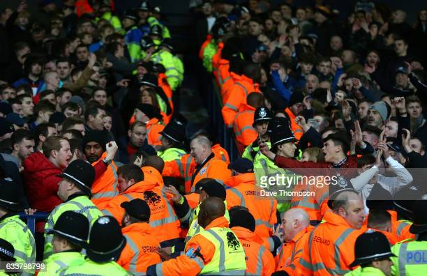 Police and stewards struggle to hold back the Stoke City and West Bromwich Albion fans after the Premier League match between West Bromwich Albion...