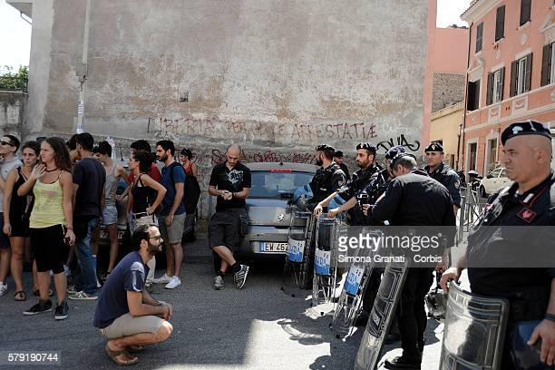 Police and the Carabinieri form lines after the dawn reoccupation of a building in via Fortebraccio which had been occupied by the group Point Break...