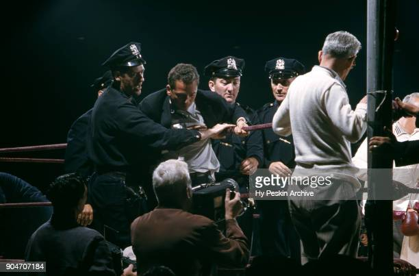 Police and trainers exit the ring before the match between Carmen Basilio and Sugar Ray Robinson for the 1957 World Middleweight Title on September...