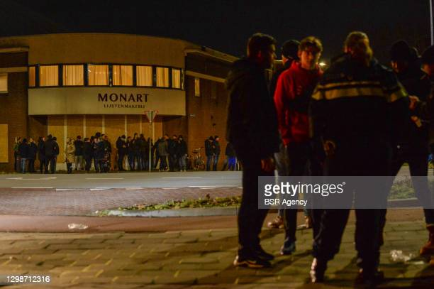 Police and ultra supporters of football club FC Den Bosch are seen in a joint attempt to prevent new riots on January 26, 2021 in Den Bosch,...