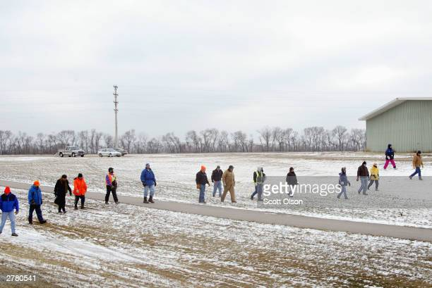 Police and volunteers fan out to search for evidence in the disappearance of Dru Sjodin in Crookston, Minnesota December 3, 2003. Sjodin, a...