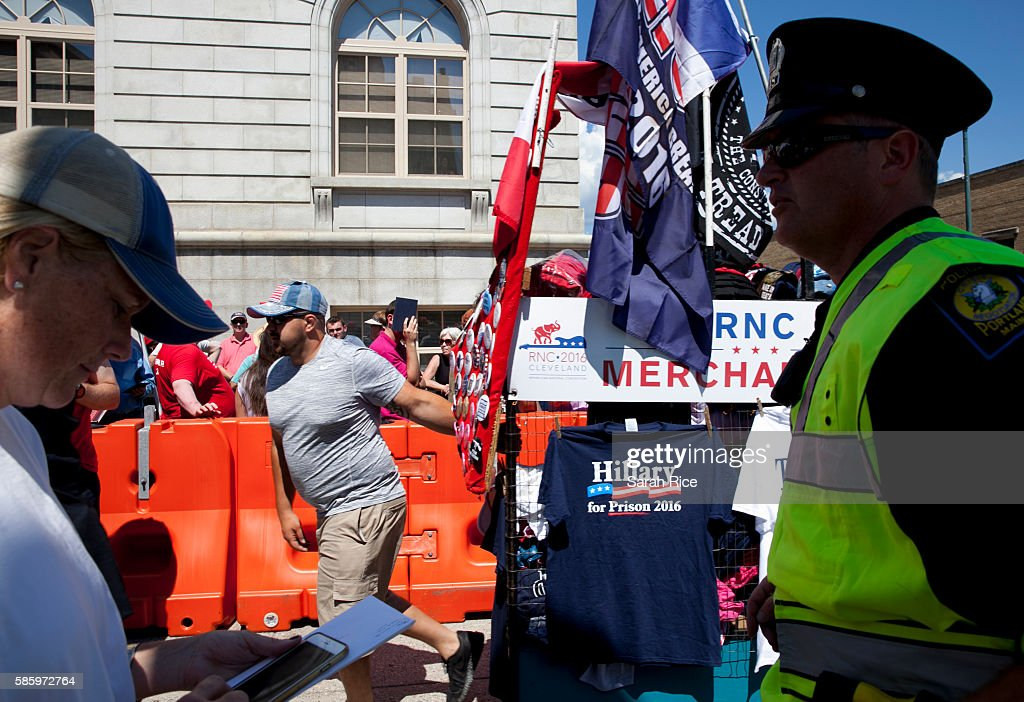 Police and workers hawking Trump gear wait outside the Merrill Auditorium before Republican Presidential candidate Donald Trump speaks on August 4, 2016 in Portland, Maine.