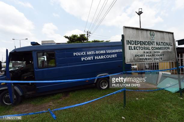 A police antibomb vehicle is parked at the main gate of the Independent National Electoral Commission headquarters in Port Harcourt Rivers State on...