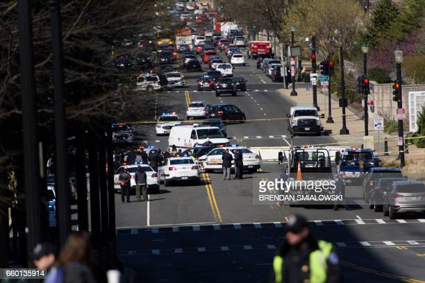 CORRECTION Police are at the scene on March 29 2017 in WashingtonDC as a driver was arrested near the US Capitol Wednesday after they drove into a...