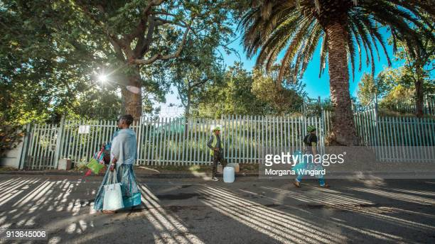 Police are now controlling Newlands Spring and limiting water collectors to carrying one 25 liter container at a time Policemen guarding the entrance...