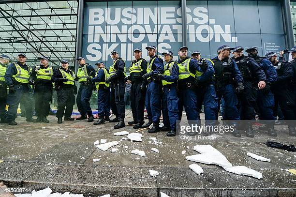 Police are pelted with missiles and smoke grenades at the Department for Business Innovation and Skills during a demonstration against education cuts...