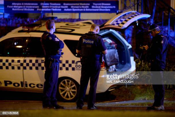 Police are pictured in the Melbourne bayside suburb of Brighton on June 5 after a woman was held against her will in an apartment block in an...