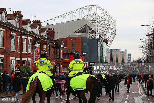 Police are pictured prior to the Premier League match between Manchester United and Middlesbrough at Old Trafford on December 31 2016 in Manchester...