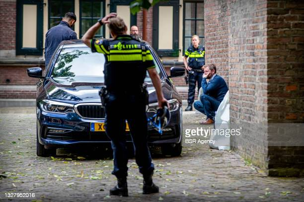 Police are seen at the Binnenhof which was cleared because a man poured gasoline over himself and threatened to set himself on fire on July 9, 2021...