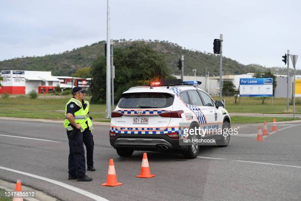 Police are seen directing traffic at the scene of the car accident on June 07, 2020 in Townsville, Australia. Four teenagers have been killed in a...
