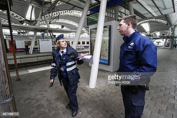 Police are seen during the evacuation of the Leuven train station after a World War II bomb was found close to the station on March 25 2015 The bomb...